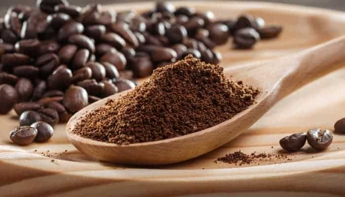 making ground coffee with a coffee grinder