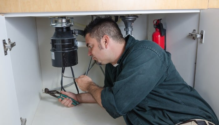What is a continuous garbage disposal?